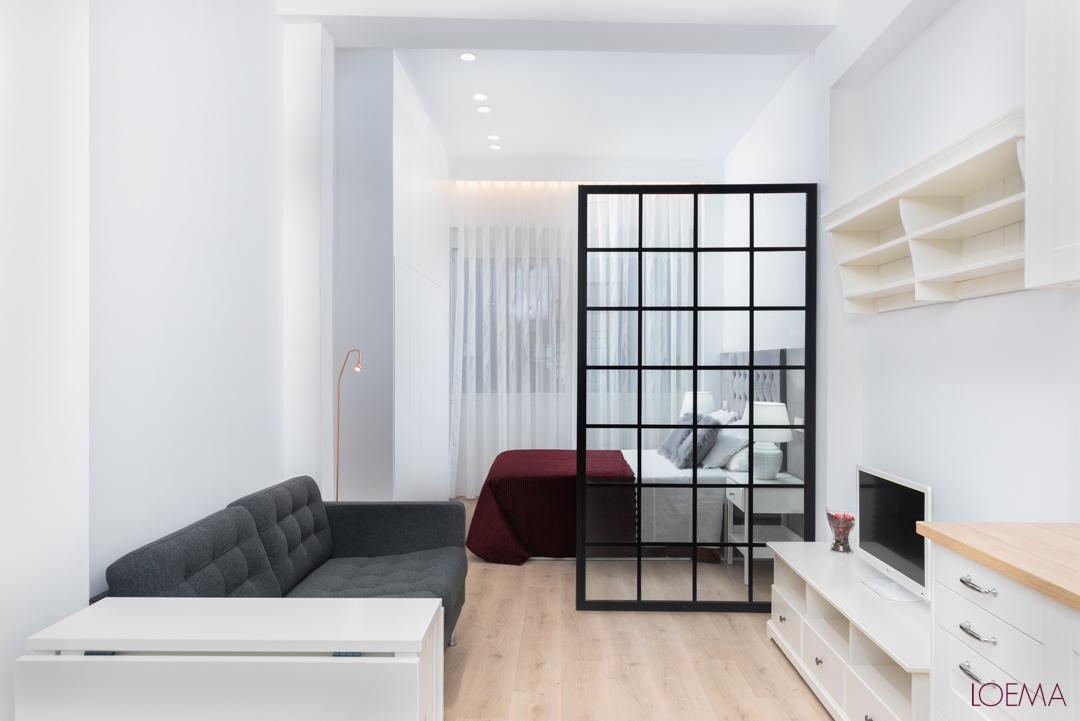 Salon y dormitorio de local convertido en vivienda en barrio Fuentes del Berro